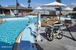 Water wheelchair showing hoist